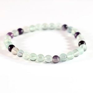 Shop Fluorite Bracelets! Natural Fluorite Small Bead Stretchy Bracelet // Elastic Bracelets // Stone Jewelry // Village Silversmith | Natural genuine Fluorite bracelets. Buy crystal jewelry, handmade handcrafted artisan jewelry for women.  Unique handmade gift ideas. #jewelry #beadedbracelets #beadedjewelry #gift #shopping #handmadejewelry #fashion #style #product #bracelets #affiliate #ad