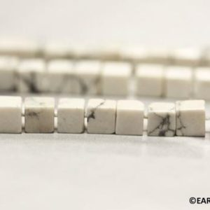 Shop Howlite Bead Shapes! S/ White Howlite 4x4mm Cube beads 16 inches long Yellowish White Gemstone Cube beads Small size beads for jewelry making Good Shape | Natural genuine other-shape Howlite beads for beading and jewelry making.  #jewelry #beads #beadedjewelry #diyjewelry #jewelrymaking #beadstore #beading #affiliate #ad