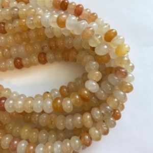 Shop Jade Rondelle Beads! Honey Jade 8x5mm Rondelle Gemstone Beads-15.5inch strand | Natural genuine rondelle Jade beads for beading and jewelry making.  #jewelry #beads #beadedjewelry #diyjewelry #jewelrymaking #beadstore #beading #affiliate #ad