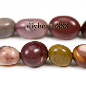 Shop Mookaite Jasper Chip & Nugget Beads! 15 inch strand of Mookaite chip bead,nugget beads,centre drilled beads 5-6mm   Natural genuine chip Mookaite Jasper beads for beading and jewelry making.  #jewelry #beads #beadedjewelry #diyjewelry #jewelrymaking #beadstore #beading #affiliate #ad