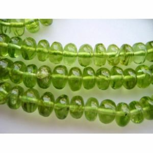 Shop Peridot Rondelle Beads! Peridot Rondelle Beads, Wholesale gemstones, 5mm Beads, 135 Pieces, 16 Inch Strand | Natural genuine rondelle Peridot beads for beading and jewelry making.  #jewelry #beads #beadedjewelry #diyjewelry #jewelrymaking #beadstore #beading #affiliate #ad
