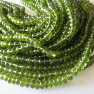 Shop Peridot Rondelle Beads! Beautiful Natural Rare AAA Peridot Smooth Rondelle Bead Wholesale gemstones 4mm To 7mm Beads 9 Inch Half Strand SKU2767/2 | Natural genuine rondelle Peridot beads for beading and jewelry making.  #jewelry #beads #beadedjewelry #diyjewelry #jewelrymaking #beadstore #beading #affiliate #ad