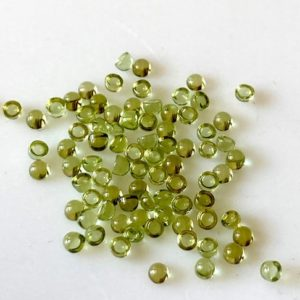 Shop Peridot Round Beads! 30 Pieces Tiny Calibrated Peridot Smooth Round Gemstones Loose, 1.5mm/2mm/3mm Melee Size Natural Peridot Flat Back Cabochon, GDS1937 | Natural genuine round Peridot beads for beading and jewelry making.  #jewelry #beads #beadedjewelry #diyjewelry #jewelrymaking #beadstore #beading #affiliate #ad