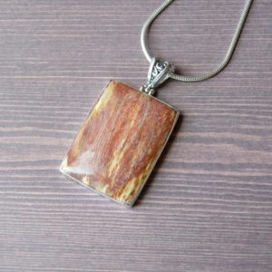 Shop Petrified Wood Pendants! Sunset Rectangular Indonesian Petrified Wood Pendant // Petrified Wood Jewelry // Sterling Silver // Village Silversmith | Natural genuine Petrified Wood pendants. Buy crystal jewelry, handmade handcrafted artisan jewelry for women.  Unique handmade gift ideas. #jewelry #beadedpendants #beadedjewelry #gift #shopping #handmadejewelry #fashion #style #product #pendants #affiliate #ad