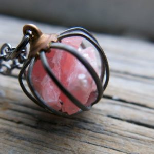 Pink Rhodochrosite Gifts Necklace Mom Gemstone Girlfriend Wife Jewelry Pastel Trending Raw Crystal Trend Spring Love Birthstone Cage Pendant | Natural genuine Gemstone necklaces. Buy crystal jewelry, handmade handcrafted artisan jewelry for women.  Unique handmade gift ideas. #jewelry #beadednecklaces #beadedjewelry #gift #shopping #handmadejewelry #fashion #style #product #necklaces #affiliate #ad