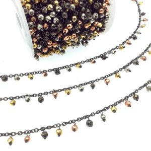 Shop Pyrite Rondelle Beads! Gunmetal Plated Copper Spaced Single Dangle Wrapped Chain With 4mm Multi Colored Plated Pyrite Rondelle Dangles – Sold By 1 Foot Length!   Natural genuine rondelle Pyrite beads for beading and jewelry making.  #jewelry #beads #beadedjewelry #diyjewelry #jewelrymaking #beadstore #beading #affiliate #ad