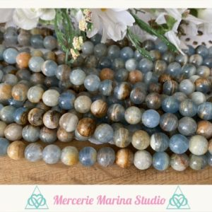Shop Blue Calcite Beads! RARES batch of blue calcite beads 8mm or 6mm untreated 100% natural | Natural genuine round Blue Calcite beads for beading and jewelry making.  #jewelry #beads #beadedjewelry #diyjewelry #jewelrymaking #beadstore #beading #affiliate #ad