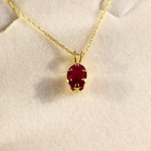 Shop Ruby Pendants! Ruby Pendant Set in Gold, Genuine Gemstone 7x5mm Oval, Set in 14 kt Yellow Gold Pendant 18inch Chain Included | Natural genuine Ruby pendants. Buy crystal jewelry, handmade handcrafted artisan jewelry for women.  Unique handmade gift ideas. #jewelry #beadedpendants #beadedjewelry #gift #shopping #handmadejewelry #fashion #style #product #pendants #affiliate #ad