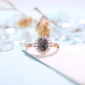 Shop Rutilated Quartz Rings! Black Rutilated Quartz engagement ring women | Rose gold ring Diamond Moissanite | Oval cut engagement ring | Bridal jewelry | Anniversary | Natural genuine Rutilated Quartz rings, simple unique alternative gemstone engagement rings. #rings #jewelry #bridal #wedding #jewelryaccessories #engagementrings #weddingideas #affiliate #ad