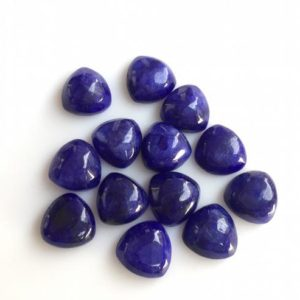 Shop Sapphire Cabochons! 25 Pieces 10mm Each Blue Corundum Sapphire Trillion Shaped Smooth Loose Cabochons SKU-GC12 | Natural genuine stones & crystals in various shapes & sizes. Buy raw cut, tumbled, or polished gemstones for making jewelry or crystal healing energy vibration raising reiki stones. #crystals #gemstones #crystalhealing #crystalsandgemstones #energyhealing #affiliate #ad