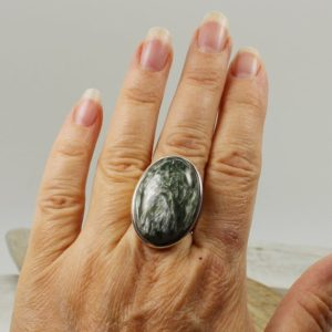 Shop Seraphinite Rings! Gorgeous stone… Seraphinite ring big oval shape green Seraphinite cab stone set on 925 sterling silver solid quality work handmade unisex   Natural genuine Seraphinite rings, simple unique handcrafted gemstone rings. #rings #jewelry #shopping #gift #handmade #fashion #style #affiliate #ad