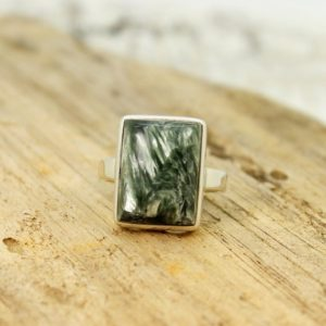 Shop Seraphinite Rings! Nice… Seraphinite ring rectangle shape green Seraphinite cab stone set on 925 sterling silver solid quality work handmade   Natural genuine Seraphinite rings, simple unique handcrafted gemstone rings. #rings #jewelry #shopping #gift #handmade #fashion #style #affiliate #ad