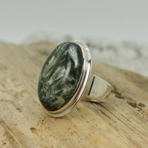 Shop Seraphinite Rings! Stunning… Seraphinite ring big oval shape green Seraphinite cab stone set on 925 sterling silver solid and durable quality work handmade   Natural genuine Seraphinite rings, simple unique handcrafted gemstone rings. #rings #jewelry #shopping #gift #handmade #fashion #style #affiliate #ad
