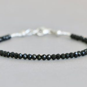 Shop Spinel Bracelets! Black Spinel Bracelet Beaded Bracelet Gemstone Bracelet Stacking Bracelet | Natural genuine Spinel bracelets. Buy crystal jewelry, handmade handcrafted artisan jewelry for women.  Unique handmade gift ideas. #jewelry #beadedbracelets #beadedjewelry #gift #shopping #handmadejewelry #fashion #style #product #bracelets #affiliate #ad