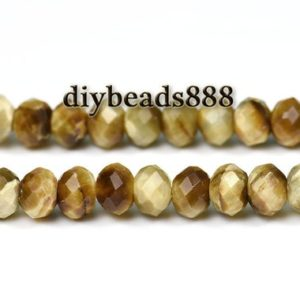 Shop Tiger Eye Faceted Beads! Gold Tiger Eye,15 inch full strand Gold Tiger Eye faceted rondelle beads,abacus beads,space beads 4x6mm | Natural genuine faceted Tiger Eye beads for beading and jewelry making.  #jewelry #beads #beadedjewelry #diyjewelry #jewelrymaking #beadstore #beading #affiliate #ad