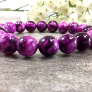Shop Sugilite Bracelets! 10mm Purple Sugilite Beaded Bracelet, Stretchy String Bracelet, Healing anxiety relief spiritual balancing calming gift for women | Natural genuine Sugilite bracelets. Buy crystal jewelry, handmade handcrafted artisan jewelry for women.  Unique handmade gift ideas. #jewelry #beadedbracelets #beadedjewelry #gift #shopping #handmadejewelry #fashion #style #product #bracelets #affiliate #ad