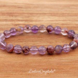 Shop Amethyst Bracelets! 6mm Amethyst Cacoxenite Bracelet, Amethyst Super Seven Bracelets 6 mm, Amethyst Melody Bracelet, Amethyst Melody Bead Bracelet, Amethyst | Natural genuine Amethyst bracelets. Buy crystal jewelry, handmade handcrafted artisan jewelry for women.  Unique handmade gift ideas. #jewelry #beadedbracelets #beadedjewelry #gift #shopping #handmadejewelry #fashion #style #product #bracelets #affiliate #ad