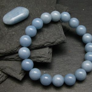 Shop Angelite Bracelets! Angelite Anhydrite Genuine Bracelet ~ 7 Inches  ~ 10mm Round Beads | Natural genuine Angelite bracelets. Buy crystal jewelry, handmade handcrafted artisan jewelry for women.  Unique handmade gift ideas. #jewelry #beadedbracelets #beadedjewelry #gift #shopping #handmadejewelry #fashion #style #product #bracelets #affiliate #ad