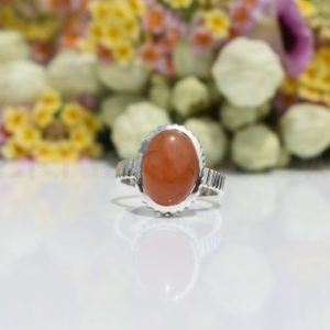 Shop Carnelian Rings! Orange Carnelian Stone Ring, Sterling Silver Ring, Cabochon Stone, Oval Shape Ring, Statement Ring, Designer Band Ring, Bezel Set Ring, Boho | Natural genuine Carnelian rings, simple unique handcrafted gemstone rings. #rings #jewelry #shopping #gift #handmade #fashion #style #affiliate #ad