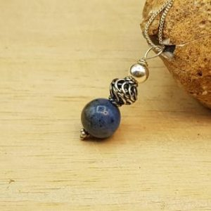 Shop Dumortierite Pendants! Small Dumortierite pendant necklace. Reiki jewelry uk. 10mm blue stone. Minimalist Blue Bali silver necklace | Natural genuine Dumortierite pendants. Buy crystal jewelry, handmade handcrafted artisan jewelry for women.  Unique handmade gift ideas. #jewelry #beadedpendants #beadedjewelry #gift #shopping #handmadejewelry #fashion #style #product #pendants #affiliate #ad