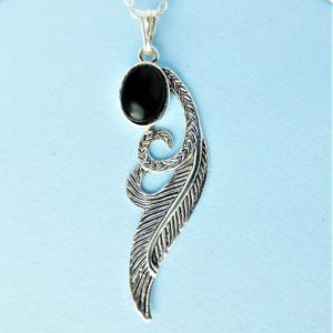 Shop Jet Pendants! Whitby Jet And Sterling Silver Angel's Wing Pendant   Natural genuine Jet pendants. Buy crystal jewelry, handmade handcrafted artisan jewelry for women.  Unique handmade gift ideas. #jewelry #beadedpendants #beadedjewelry #gift #shopping #handmadejewelry #fashion #style #product #pendants #affiliate #ad