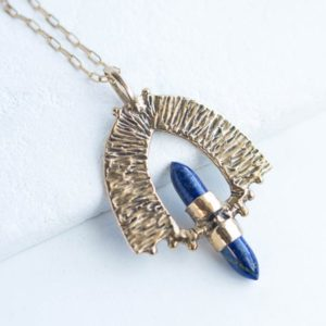 Shop Lapis Lazuli Jewelry! PETRA / Lapis Lazuli Necklace, Bronze Pendant, Crystal Point Necklace, Statement Necklace, Bohemian Necklace, Warrior Jewelry | Natural genuine Lapis Lazuli jewelry. Buy crystal jewelry, handmade handcrafted artisan jewelry for women.  Unique handmade gift ideas. #jewelry #beadedjewelry #beadedjewelry #gift #shopping #handmadejewelry #fashion #style #product #jewelry #affiliate #ad