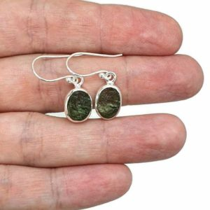 Shop Moldavite Earrings! Moldavite Earrings, Sterling Silver, Oval Shaped, Meteorite Stone, Forest green / Olive green Gem, Holy Grail Stone, Psychic Protection   Natural genuine Moldavite earrings. Buy crystal jewelry, handmade handcrafted artisan jewelry for women.  Unique handmade gift ideas. #jewelry #beadedearrings #beadedjewelry #gift #shopping #handmadejewelry #fashion #style #product #earrings #affiliate #ad