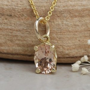Shop Morganite Pendants! Dainty Oval Morganite Pendant 7x5mm Peachy Pink in Solid Gold LS5688 | Natural genuine Morganite pendants. Buy crystal jewelry, handmade handcrafted artisan jewelry for women.  Unique handmade gift ideas. #jewelry #beadedpendants #beadedjewelry #gift #shopping #handmadejewelry #fashion #style #product #pendants #affiliate #ad