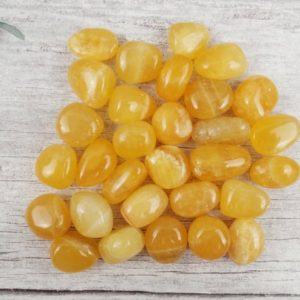 Shop Orange Calcite Stones & Crystals! Orange Calcite Tumbled Stones, Reiki Infused Wire Wrapping Self Care Healing Crystals | Natural genuine stones & crystals in various shapes & sizes. Buy raw cut, tumbled, or polished gemstones for making jewelry or crystal healing energy vibration raising reiki stones. #crystals #gemstones #crystalhealing #crystalsandgemstones #energyhealing #affiliate #ad