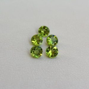 Shop Peridot Earrings! 2 pcs Light green Peridot loose round gemstone Natural stones for jewelry 7mm Calibrated gemstones for earrings | Natural genuine Peridot earrings. Buy crystal jewelry, handmade handcrafted artisan jewelry for women.  Unique handmade gift ideas. #jewelry #beadedearrings #beadedjewelry #gift #shopping #handmadejewelry #fashion #style #product #earrings #affiliate #ad