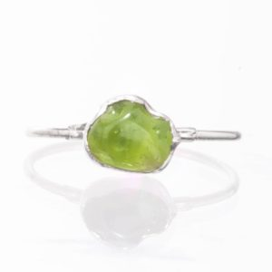 Raw Peridot Ring, Sterling Silver August Birthstone Ring, Peridot Jewelry, Raw Stone Ring, Dainty Ring, Green Stone Ring, Gift for Her | Natural genuine Peridot jewelry. Buy crystal jewelry, handmade handcrafted artisan jewelry for women.  Unique handmade gift ideas. #jewelry #beadedjewelry #beadedjewelry #gift #shopping #handmadejewelry #fashion #style #product #jewelry #affiliate #ad