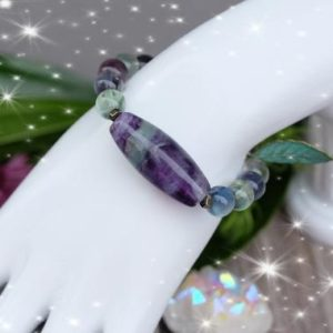 INTUITION Large Barrel AAA Rainbow Fluorite 10mm Rainbow Inclusion Fluorite Bead Stretch Bracelet Antique Copper Leaf Charm | Natural genuine Gemstone bracelets. Buy crystal jewelry, handmade handcrafted artisan jewelry for women.  Unique handmade gift ideas. #jewelry #beadedbracelets #beadedjewelry #gift #shopping #handmadejewelry #fashion #style #product #bracelets #affiliate #ad