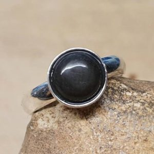 Shop Rainbow Obsidian Rings! Rainbow Obsidian adjustable ring. Minimalist 925 Sterling silver rings for women. Reiki jewelry uk. Black semi precious stone 8mm.   Natural genuine Rainbow Obsidian rings, simple unique handcrafted gemstone rings. #rings #jewelry #shopping #gift #handmade #fashion #style #affiliate #ad