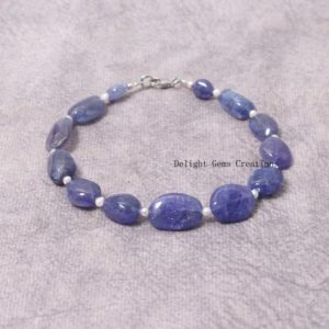 Shop Tanzanite Bracelets! AAA++ Natural Tanzanite Beaded Bracelet, Tanzanite Smooth/Plain Tumble Bead Bracelet// 8 Inch Bracelet, Tanzanite Halloween Beaded Jewelry | Natural genuine Tanzanite bracelets. Buy crystal jewelry, handmade handcrafted artisan jewelry for women.  Unique handmade gift ideas. #jewelry #beadedbracelets #beadedjewelry #gift #shopping #handmadejewelry #fashion #style #product #bracelets #affiliate #ad
