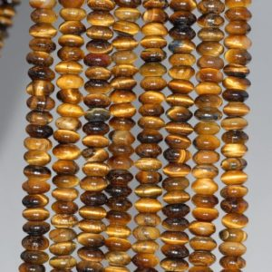 Shop Tiger Eye Rondelle Beads! 6X3MM Yellow Tiger Eye Gemstone Grade A Rondelle Loose Beads 16 inch Full Strand (80000485-A75) | Natural genuine rondelle Tiger Eye beads for beading and jewelry making.  #jewelry #beads #beadedjewelry #diyjewelry #jewelrymaking #beadstore #beading #affiliate #ad
