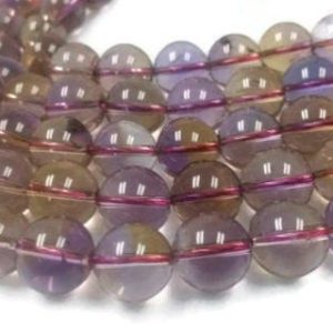 Shop Ametrine Round Beads! 12MM Super Fine Quality , Ametrine Round Beads, 15.5 Inch Strand,AAAA QUALITY . Natural Ametrine in mix color shade | Natural genuine round Ametrine beads for beading and jewelry making.  #jewelry #beads #beadedjewelry #diyjewelry #jewelrymaking #beadstore #beading #affiliate #ad