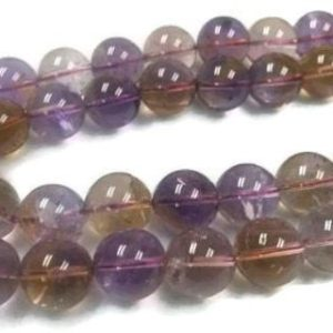 Shop Ametrine Round Beads! 16MM Super Fine Quality , Ametrine Round Beads, 15.5 Inch Strand,AAA QUALITY . Natural Ametrine in mix color shade | Natural genuine round Ametrine beads for beading and jewelry making.  #jewelry #beads #beadedjewelry #diyjewelry #jewelrymaking #beadstore #beading #affiliate #ad