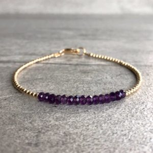 Shop Amethyst Bracelets! Purple Amethyst Bracelet | Tiny Silver or Gold Beads | Dainty Delicate Amethyst Jewelry | February Birthstone Gift for Women | Faceted Gems | Natural genuine Amethyst bracelets. Buy crystal jewelry, handmade handcrafted artisan jewelry for women.  Unique handmade gift ideas. #jewelry #beadedbracelets #beadedjewelry #gift #shopping #handmadejewelry #fashion #style #product #bracelets #affiliate #ad