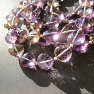 Shop Ametrine Faceted Beads! Ametrine Drilled through Hearts • 10.50-11mm • AAA+ micro faceted • Natural gemstone coin rondelles • Pale purple lavender champagne   Natural genuine faceted Ametrine beads for beading and jewelry making.  #jewelry #beads #beadedjewelry #diyjewelry #jewelrymaking #beadstore #beading #affiliate #ad