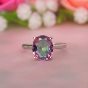 Shop Angel Aura Quartz Rings! Mystic Aura quartz ring, Solitaire rings, oval mystic quartz ring,handmade ring, Mercury mystic quartz, silver ring, Angel aura quartz ring   Natural genuine Angel Aura Quartz rings, simple unique handcrafted gemstone rings. #rings #jewelry #shopping #gift #handmade #fashion #style #affiliate #ad