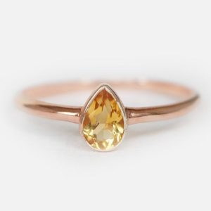 14k gold pear citrine ring, citrine ring, engagement ring, pear bezel ring, 14k pear ring, dainty ring, solid gold, bezel ring, pear citrine | Natural genuine Array rings, simple unique alternative gemstone engagement rings. #rings #jewelry #bridal #wedding #jewelryaccessories #engagementrings #weddingideas #affiliate #ad