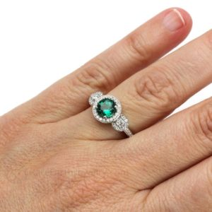 Shop Emerald Jewelry! Emerald Engagement Ring Emerald Ring 3 Stone Ring with Diamond Halo Design May Birthstone Green Stone in Gold or Platinum | Natural genuine Emerald jewelry. Buy handcrafted artisan wedding jewelry.  Unique handmade bridal jewelry gift ideas. #jewelry #beadedjewelry #gift #crystaljewelry #shopping #handmadejewelry #wedding #bridal #jewelry #affiliate #ad