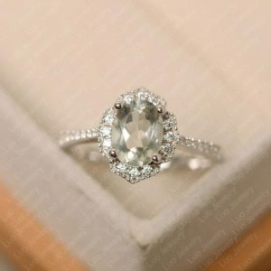 Shop Green Amethyst Rings! Green amethyst ring, oval cut, halo ring, white gold, wedding ring for women | Natural genuine Green Amethyst rings, simple unique alternative gemstone engagement rings. #rings #jewelry #bridal #wedding #jewelryaccessories #engagementrings #weddingideas #affiliate #ad