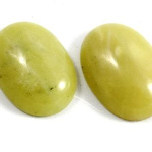 Shop Jade Cabochons! Greenish Yellow Jade Cabochon. An Oval Shaped Stone for Making Fancy Picture Frame Crafts. A Yellowish Green Colored Gemstone for Jewelry | Natural genuine stones & crystals in various shapes & sizes. Buy raw cut, tumbled, or polished gemstones for making jewelry or crystal healing energy vibration raising reiki stones. #crystals #gemstones #crystalhealing #crystalsandgemstones #energyhealing #affiliate #ad