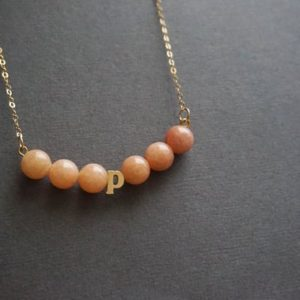 Shop Orange Calcite Jewelry! Initial Necklace Beaded Necklace Orange Necklace Orange Calcite Necklace Custom Initial Necklace 14kt Gold Filled Necklace Gemstone Necklace | Natural genuine Orange Calcite jewelry. Buy crystal jewelry, handmade handcrafted artisan jewelry for women.  Unique handmade gift ideas. #jewelry #beadedjewelry #beadedjewelry #gift #shopping #handmadejewelry #fashion #style #product #jewelry #affiliate #ad