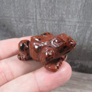 Shop Mahogany Obsidian Shapes! Mahogany Obsidian Stone 1.5 inch Frog Figurine Fig91   Natural genuine stones & crystals in various shapes & sizes. Buy raw cut, tumbled, or polished gemstones for making jewelry or crystal healing energy vibration raising reiki stones. #crystals #gemstones #crystalhealing #crystalsandgemstones #energyhealing #affiliate #ad