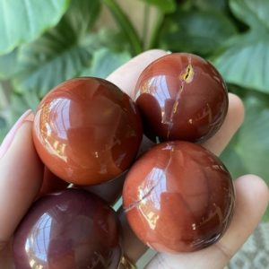 Shop Mookaite Jasper Shapes! Red Mookaite Sphere, Orb | Natural genuine stones & crystals in various shapes & sizes. Buy raw cut, tumbled, or polished gemstones for making jewelry or crystal healing energy vibration raising reiki stones. #crystals #gemstones #crystalhealing #crystalsandgemstones #energyhealing #affiliate #ad