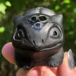 Shop Obsidian Shapes! Black Obsidian Bulbasaur Carving  Crystal  Figurine #3   Natural genuine stones & crystals in various shapes & sizes. Buy raw cut, tumbled, or polished gemstones for making jewelry or crystal healing energy vibration raising reiki stones. #crystals #gemstones #crystalhealing #crystalsandgemstones #energyhealing #affiliate #ad
