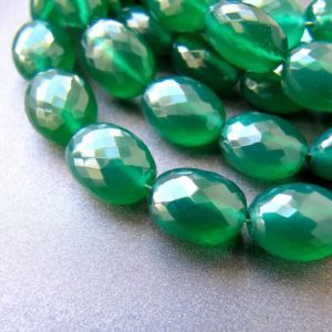 Shop Onyx Chip & Nugget Beads! Green onyx ovals • 10.50-11mm • Pairs available • AAA micro faceted oval nuggets • Kelly emerald green | Natural genuine chip Onyx beads for beading and jewelry making.  #jewelry #beads #beadedjewelry #diyjewelry #jewelrymaking #beadstore #beading #affiliate #ad