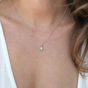 Shop Opal Necklaces! Pear Fire Opal Necklace in Rose Gold with Pave Diamonds by Threelayers | Natural genuine Opal necklaces. Buy crystal jewelry, handmade handcrafted artisan jewelry for women.  Unique handmade gift ideas. #jewelry #beadednecklaces #beadedjewelry #gift #shopping #handmadejewelry #fashion #style #product #necklaces #affiliate #ad